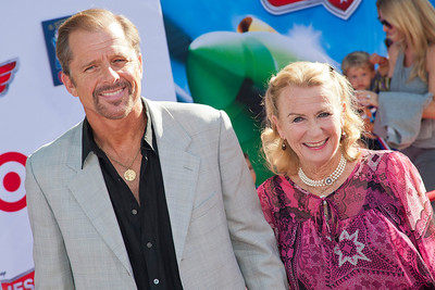 HOLLYWOOD, CA - AUGUST 05: Actors Maxwell Caulfield and Juliet Mills arrive at the Los Angeles premiere of 'Planes' at the El Capitan Theatre on Monday August 5, 2013 in Hollywood, California. (Photo by Tom Sorensen/Moovieboy Pictures)