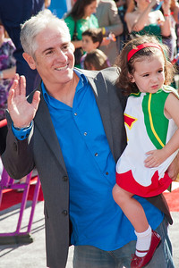 HOLLYWOOD, CA - AUGUST 05: Actor Carlos Alazraqui and guest arrive at the Los Angeles premiere of 'Planes' at the El Capitan Theatre on Monday August 5, 2013 in Hollywood, California. (Photo by Tom Sorensen/Moovieboy Pictures)