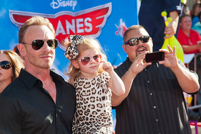 HOLLYWOOD, CA - AUGUST 05: Actor Ian Ziering, daughter and actor Gabriel Iglesias arrive at the Los Angeles premiere of 'Planes' at the El Capitan Theatre on Monday August 5, 2013 in Hollywood, California. (Photo by Tom Sorensen/Moovieboy Pictures)