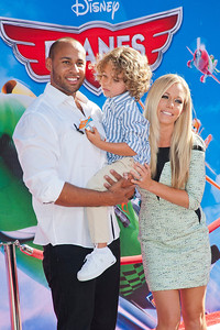 HOLLYWOOD, CA - AUGUST 05: Hank Baskett, son Hank and actress Kendra Wilkinson arrive at the Los Angeles premiere of 'Planes' at the El Capitan Theatre on Monday August 5, 2013 in Hollywood, California. (Photo by Tom Sorensen/Moovieboy Pictures)