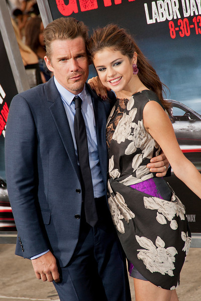 WESTWOOD, CA - AUGUST 26: Actor Ethan Hawke and actress/singer Selena Gomez attend the premiere of 'Getaway' presented by Warner Bros. Pictures at Regency Village Theatre on Monday, August 26, 2013 in Westwood, California. (Photo by Tom Sorensen/Moovieboy Pictures)