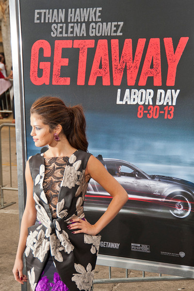 WESTWOOD, CA - AUGUST 26: Actress/singer Selena Gomez attends the premiere of 'Getaway' presented by Warner Bros. Pictures at Regency Village Theatre on Monday, August 26, 2013 in Westwood, California. (Photo by Tom Sorensen/Moovieboy Pictures)