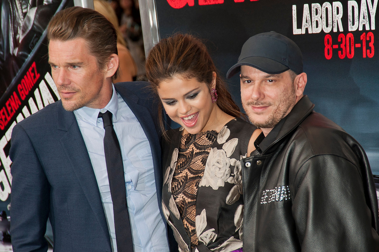 WESTWOOD, CA - AUGUST 26: Actor Ethan Hawke, director Courtney Solomon and actress/singer Selena Gomez attend the premiere of 'Getaway' presented by Warner Bros. Pictures at Regency Village Theatre on Monday, August 26, 2013 in Westwood, California. (Photo by Tom Sorensen/Moovieboy Pictures)