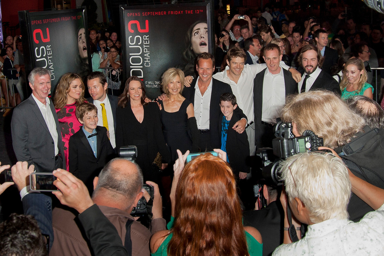 UNIVERSAL CITY, CA - SEPTEMBER 10: Actors Steve Coulter, Rose Bryne, Ty Simpkins, actor/writer Leigh Whannell, Barbara Hershey, Lin Shaye, Patrick Wilson, Andrew Astor, Producer Jason Blum, guest, actors Angus Sampson and Lindsay Seim attend the premiere of FilmDistrict's 'Insidious: Chapter 2' at Universal CityWalk on Tuesday, September 10, 2013 in Universal City, California. (Photo by Tom Sorensen/Moovieboy Pictures)