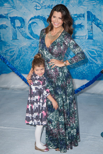 HOLLYWOOD, CA - NOVEMBER 19: Actress Ali Landry and daughter arrive at the premiere of Walt Disney Animation Studios' 'Frozen'at the El Capitan Theatre on Tuesday, November 19, 2013 in Hollywood, California. (Photo by Tom Sorensen/Moovieboy Pictures)