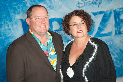 HOLLYWOOD, CA - NOVEMBER 19: COO of Pixar/Walt Disney Animation Studios John Lasseter (R) and Nancy Lasseter arrive at the premiere of Walt Disney Animation Studios' 'Frozen'at the El Capitan Theatre on Tuesday, November 19, 2013 in Hollywood, California. (Photo by Tom Sorensen/Moovieboy Pictures)