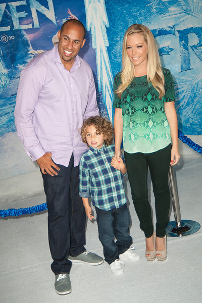 HOLLYWOOD, CA - NOVEMBER 19: (L-R) Athlete Hank Baskett, Hank Baskett IV and TV personality Kendra Wilkinson arrive at the premiere of Walt Disney Animation Studios' 'Frozen'at the El Capitan Theatre on Tuesday, November 19, 2013 in Hollywood, California. (Photo by Tom Sorensen/Moovieboy Pictures)