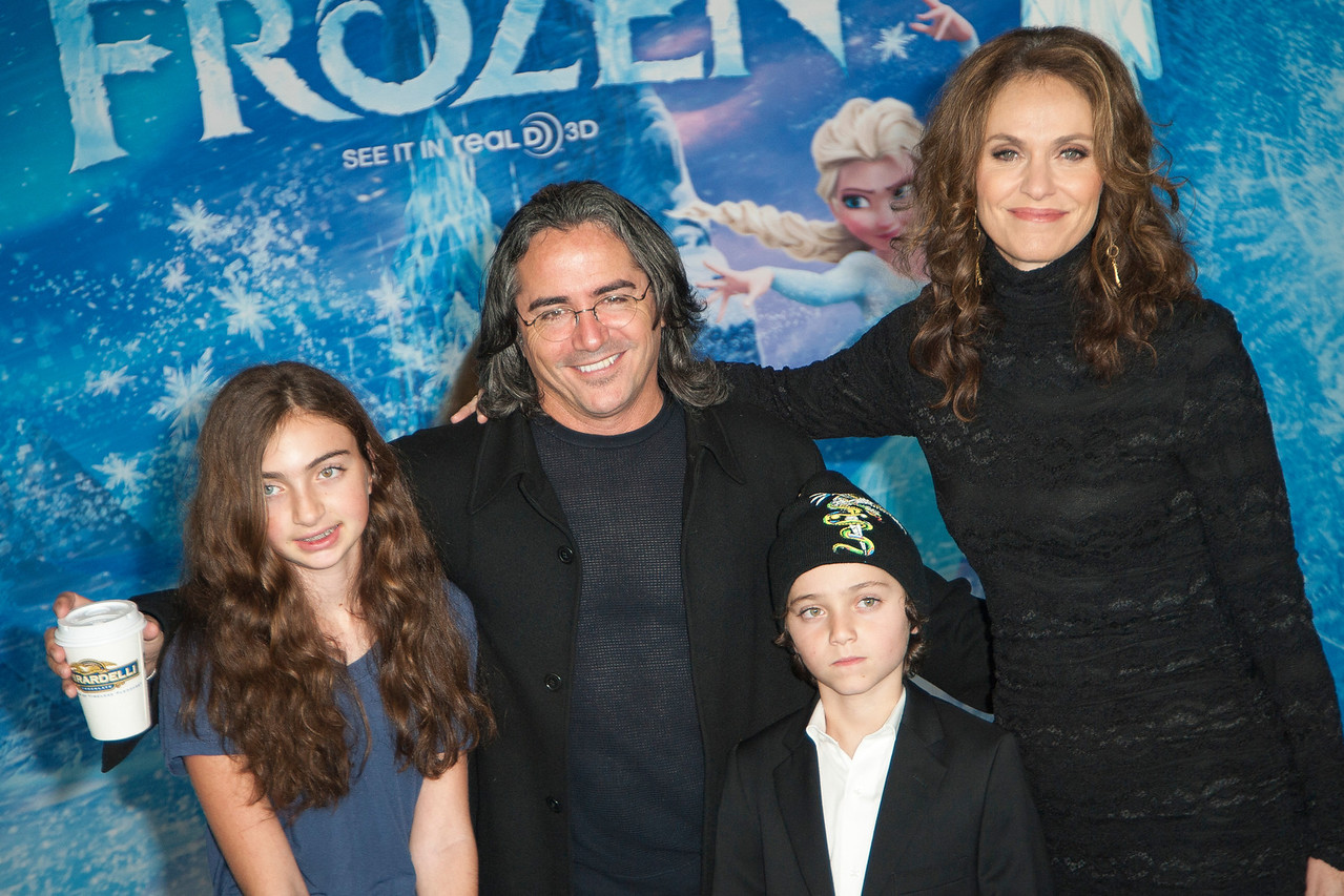 HOLLYWOOD, CA - NOVEMBER 19: Actress Amy Brenneman (R) and family arrive at the premiere of Walt Disney Animation Studios' 'Frozen'at the El Capitan Theatre on Tuesday, November 19, 2013 in Hollywood, California. (Photo by Tom Sorensen/Moovieboy Pictures)