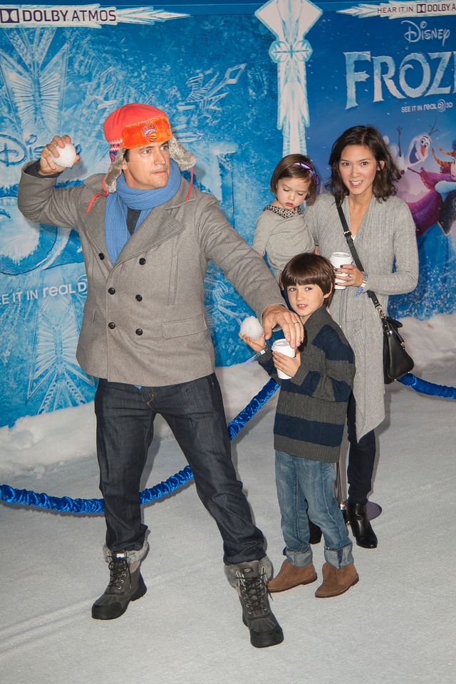 HOLLYWOOD, CA - NOVEMBER 19: Actor Ken Marino (orange cap), Erica Oyama, Ruby Marino, and Riley Kenichi Marino arrive at the premiere of Walt Disney Animation Studios' 'Frozen'at the El Capitan Theatre on Tuesday, November 19, 2013 in Hollywood, California. (Photo by Tom Sorensen/Moovieboy Pictures)
