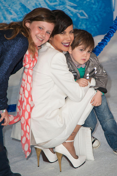 HOLLYWOOD, CA - NOVEMBER 19: Actress Catherine Bell and kids arrive at the premiere of Walt Disney Animation Studios' 'Frozen'at the El Capitan Theatre on Tuesday, November 19, 2013 in Hollywood, California. (Photo by Tom Sorensen/Moovieboy Pictures)