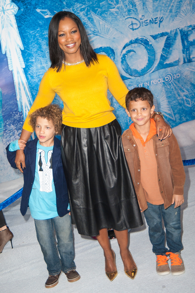 HOLLYWOOD, CA - NOVEMBER 19: Actress Garcelle Beauvais and family arrive at the premiere of Walt Disney Animation Studios' 'Frozen'at the El Capitan Theatre on Tuesday, November 19, 2013 in Hollywood, California. (Photo by Tom Sorensen/Moovieboy Pictures)