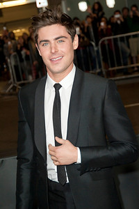 LOS ANGELES, CA - JANUARY 27: Actor Zac Efron arrives at the premiere of Focus Features' 'That Awkward Moment' at Regal Cinemas L.A. Live on January 27, 2014 in Los Angeles, California. (Photo by Tom Sorensen/Moovieboy Pictures)