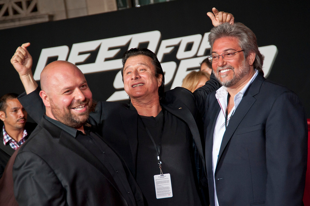 HOLLYWOOD, CA - MARCH 06: Composer Nathan Furst, Steve Perry and guest arrive at the premiere of DreamWorks Pictures' 'Need For Speed' at TCL Chinese Theatre on March 6, 2014 in Hollywood, California. (Photo by Tom Sorensen/Moovieboy Pictures)