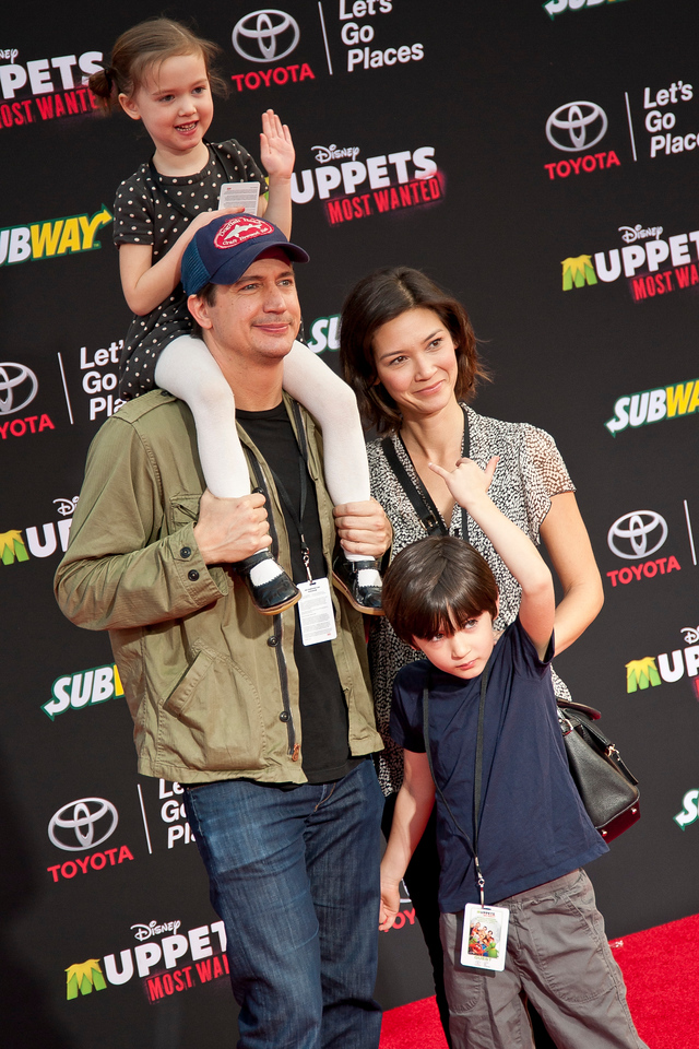 HOLLYWOOD, CA - MARCH 11: Actor Ken Marino (wearing cap), Erica Oyama, Ruby Marino, and Riley Kenichi Marino arrive for the premiere of Disney's 'Muppets Most Wanted' at the El Capitan Theatre on Tuesday March 11, 2014 in Hollywood, California. (Photo by Tom Sorensen/Moovieboy Pictures)