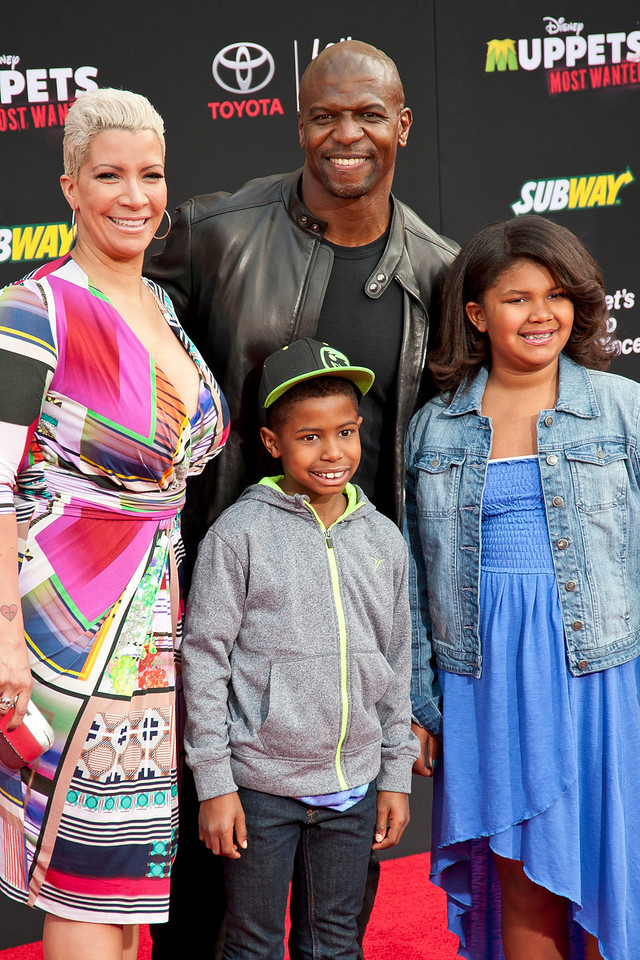 HOLLYWOOD, CA - MARCH 11: Actor Terry Crews (R), wife TV personality Rebecca Crews arrive and family arrive for the premiere of Disney's 'Muppets Most Wanted' at the El Capitan Theatre on Tuesday March 11, 2014 in Hollywood, California. (Photo by Tom Sorensen/Moovieboy Pictures)