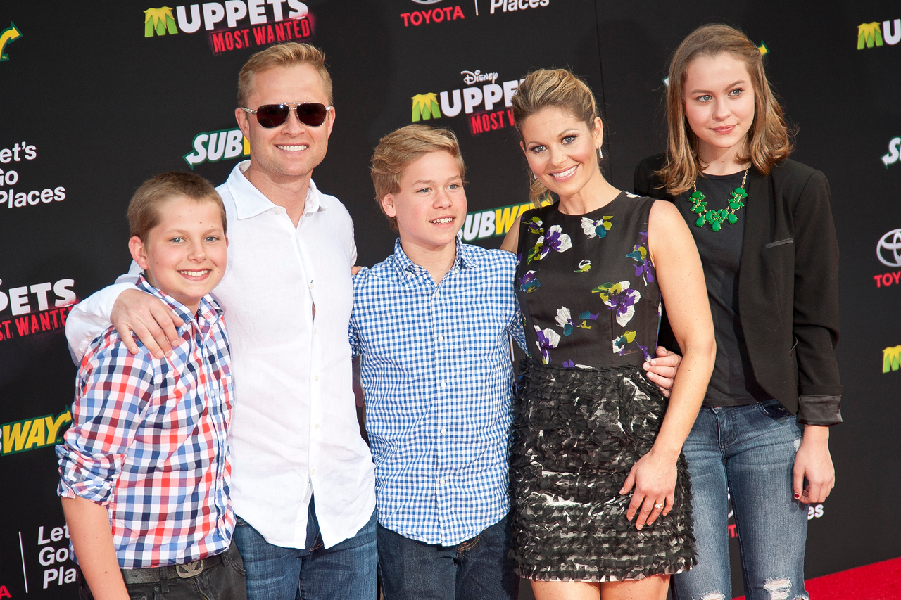 HOLLYWOOD, CA - MARCH 11: Actress Candice Cameron Bure (Second R) and family arrive for the premiere of Disney's 'Muppets Most Wanted' at the El Capitan Theatre on Tuesday March 11, 2014 in Hollywood, California. (Photo by Tom Sorensen/Moovieboy Pictures)