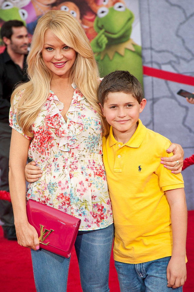 HOLLYWOOD, CA - MARCH 11: Actress Charlotte Ross and son Max Goldman arrive for the premiere of Disney's 'Muppets Most Wanted' at the El Capitan Theatre on Tuesday March 11, 2014 in Hollywood, California. (Photo by Tom Sorensen/Moovieboy Pictures)