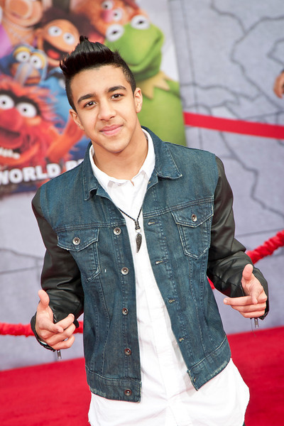 HOLLYWOOD, CA - MARCH 11: Musician Miguelito arrives for the premiere of Disney's 'Muppets Most Wanted' at the El Capitan Theatre on Tuesday March 11, 2014 in Hollywood, California. (Photo by Tom Sorensen/Moovieboy Pictures)