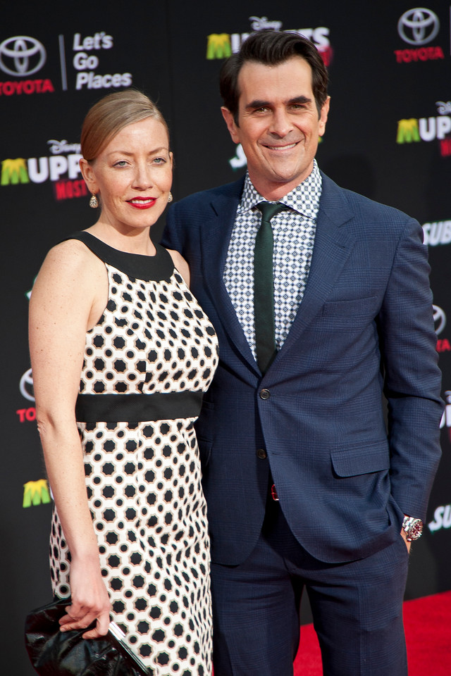 HOLLYWOOD, CA - MARCH 11: Actor Ty Burrell and wife Holly Burrell arrive for the premiere of Disney's 'Muppets Most Wanted' at the El Capitan Theatre on Tuesday March 11, 2014 in Hollywood, California. (Photo by Tom Sorensen/Moovieboy Pictures)
