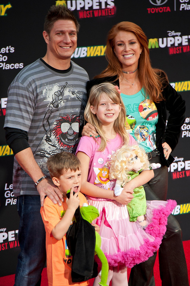 HOLLYWOOD, CA - MARCH 11: Angie Everhart and family arrive for the premiere of Disney's 'Muppets Most Wanted' at the El Capitan Theatre on Tuesday March 11, 2014 in Hollywood, California. (Photo by Tom Sorensen/Moovieboy Pictures)