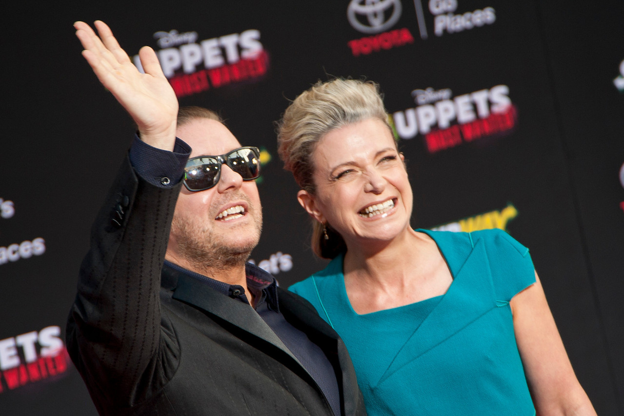 HOLLYWOOD, CA - MARCH 11: Actor/Comedian Ricky Gervais and Jane Fallon arrive for the premiere of Disney's 'Muppets Most Wanted' at the El Capitan Theatre on Tuesday March 11, 2014 in Hollywood, California. (Photo by Tom Sorensen/Moovieboy Pictures)