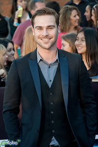 LOS ANGELES, CA - MARCH 18: Actor Grey Damon arrives at the premiere of Summit Entertainment's 'Divergent' at the Regency Bruin Theatre on Tuesday, March 18, 2014 in Los Angeles, California. (Photo by Tom Sorensen/Moovieboy Pictures)