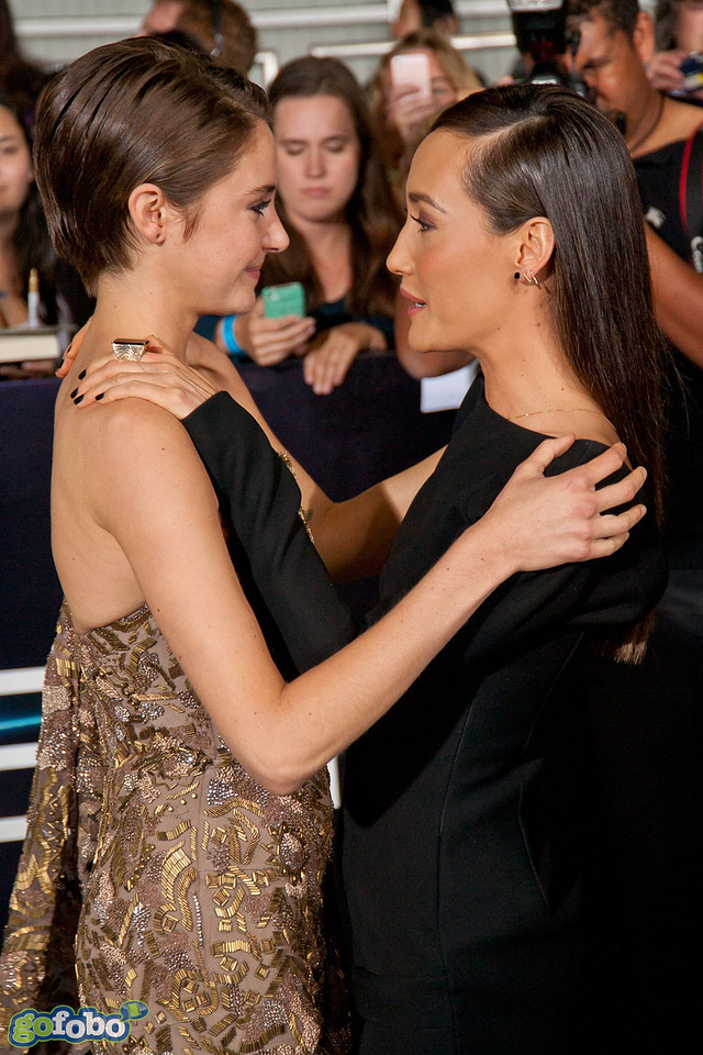 LOS ANGELES, CA - MARCH 18: Actresses Shailene Woodley and Maggie Q arrive at the premiere of Summit Entertainment's 'Divergent' at the Regency Bruin Theatre on Tuesday, March 18, 2014 in Los Angeles, California. (Photo by Tom Sorensen/Moovieboy Pictures)