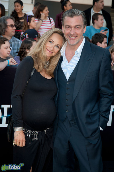 LOS ANGELES, CA - MARCH 18: Actor Ray Stevenson (R) and Elisabetta Caraccia arrive at the premiere of Summit Entertainment's 'Divergent' at the Regency Bruin Theatre on Tuesday, March 18, 2014 in Los Angeles, California. (Photo by Tom Sorensen/Moovieboy Pictures)