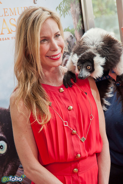 "LOS ANGELES, CA - MARCH 29: Mireya Mayor and a lemur named ""Remy"" arrive at the premiere of 'Island Of Lemurs: Madagascar' at California Science Center on Saturday, March 29, 2014 in Los Angeles, California. (Photo by Tom Sorensen/Moovieboy Pictures)"