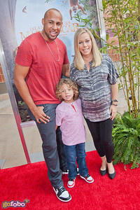LOS ANGELES, CA - MARCH 29: Reality TV Personalities Hank Baskett, Hank Baskett IV and Kendra Wilkinson arrive at the premiere of 'Island Of Lemurs: Madagascar' at California Science Center on Saturday, March 29, 2014 in Los Angeles, California. (Photo by Tom Sorensen/Moovieboy Pictures)
