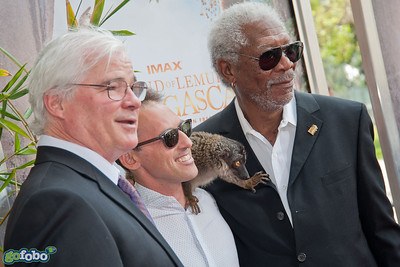 "LOS ANGELES, CA - MARCH 29: Director David Douglas, Writer/Producer Drew Fellman, actor Morgan Freeman and a lemur named ""Taj"" arrive at the premiere of 'Island Of Lemurs: Madagascar' at California Science Center on Saturday, March 29, 2014 in Los Angeles, California. (Photo by Tom Sorensen/Moovieboy Pictures)"