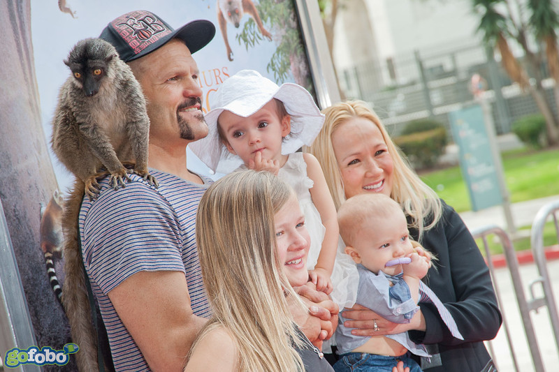 """LOS ANGELES, CA - MARCH 29: UFC fighter Chuck Liddell, his family and a lemur named """"Taj"""" arrive at the premiere of 'Island Of Lemurs: Madagascar' at California Science Center on Saturday, March 29, 2014 in Los Angeles, California. (Photo by Tom Sorensen/Moovieboy Pictures)"""