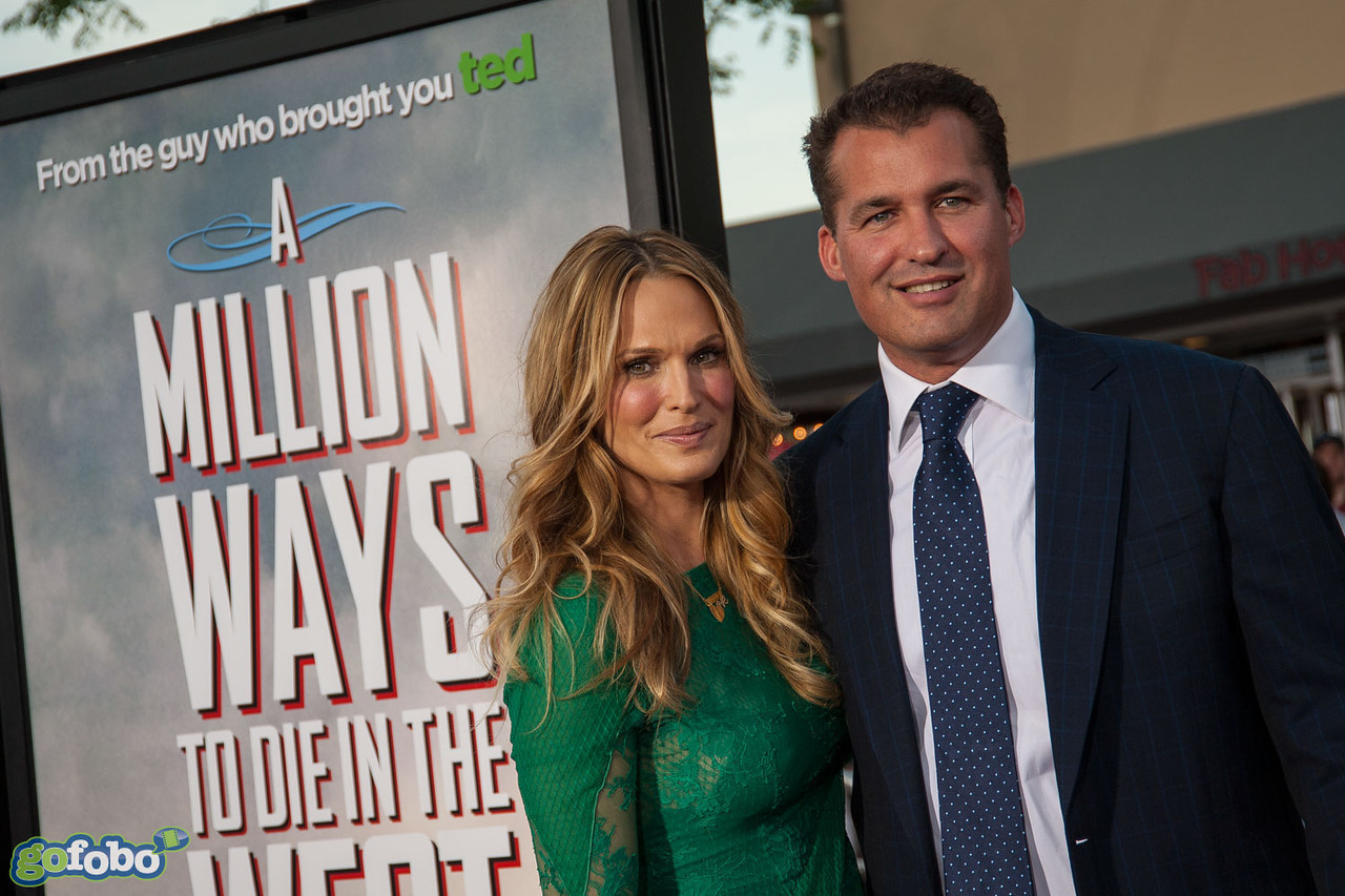 WESTWOOD, CA - MAY 15: Producer Scott Stuber and actress Molly Sim arrive at the premiere of Universal Pictures and MRC's 'A Million Ways To Die In The West' at Regency Village Theatre on Thursday May 15, 2014 in Westwood, California. (Photo by Tom Sorensen/Moovieboy Pictures)