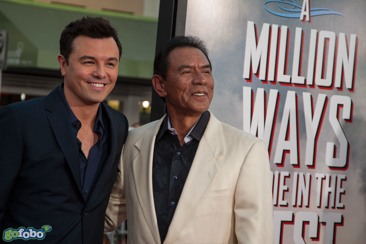 WESTWOOD, CA - MAY 15: Actor/Director/Writer Seth MacFarlane (L) and actor Wes Studi arrive at the premiere of Universal Pictures and MRC's 'A Million Ways To Die In The West' at Regency Village Theatre on Thursday May 15, 2014 in Westwood, California. (Photo by Tom Sorensen/Moovieboy Pictures)