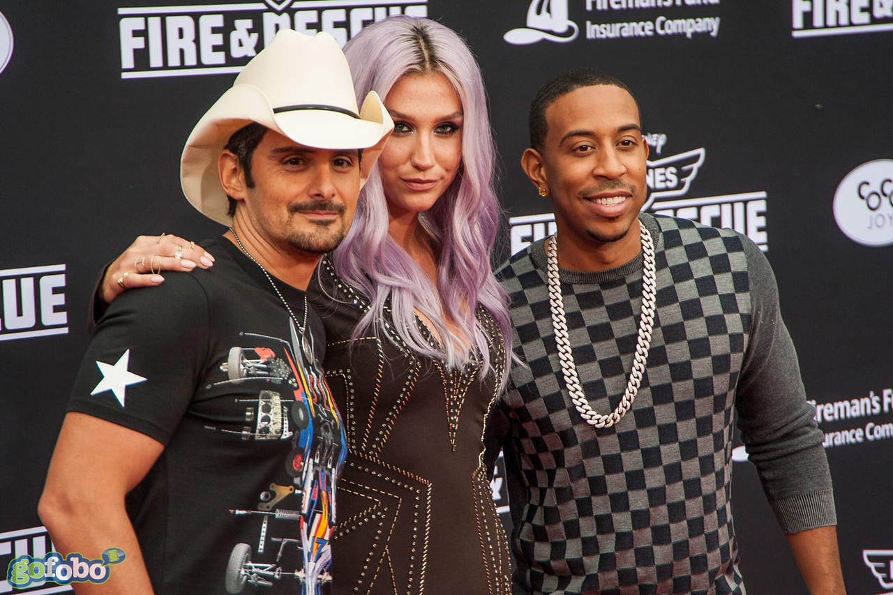 HOLLYWOOD, CA - JULY 15: (L-R) Recording artist Brad Paisley, Kesha and Chris 'Ludacris' Bridges attend the premiere of Disney's 'Planes: Fire & Rescue' at the El Capitan Theatre on Tuesday July 15, 2014 in Hollywood, California. (Photo by Tom Sorensen/Moovieboy Pictures)