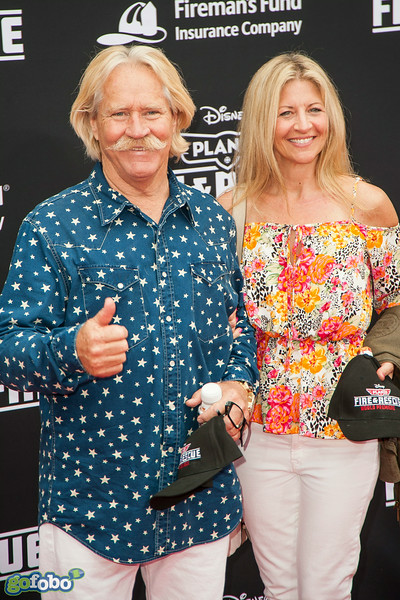 HOLLYWOOD, CA - JULY 15: Aerobatic helicopter pilot Chuck Aaron and Wendi Aaron attend the premiere of Disney's 'Planes: Fire & Rescue' at the El Capitan Theatre on Tuesday July 15, 2014 in Hollywood, California. (Photo by Tom Sorensen/Moovieboy Pictures)