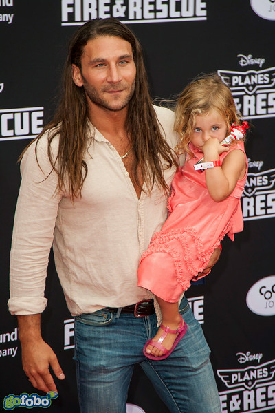 HOLLYWOOD, CA - JULY 15: Actor Zach McGowan and guest attend the premiere of Disney's 'Planes: Fire & Rescue' at the El Capitan Theatre on Tuesday July 15, 2014 in Hollywood, California. (Photo by Tom Sorensen/Moovieboy Pictures)
