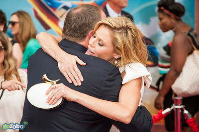 HOLLYWOOD, CA - JULY 15: Pixar chief creative officer John Lasseter and actress Julie Bowen attend the premiere of Disney's 'Planes: Fire & Rescue' at the El Capitan Theatre on Tuesday July 15, 2014 in Hollywood, California. (Photo by Tom Sorensen/Moovieboy Pictures)