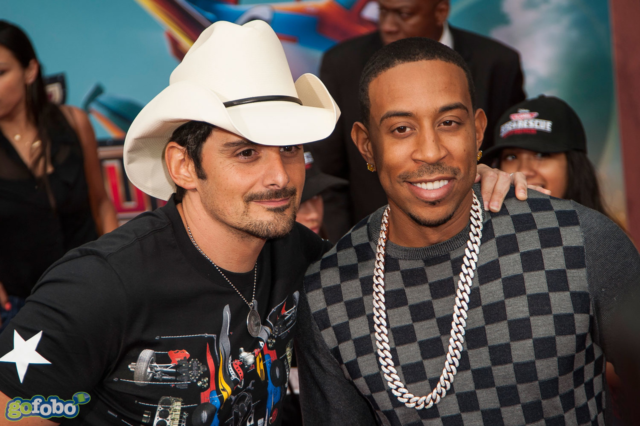 HOLLYWOOD, CA - JULY 15: (L-R) Recording artist Brad Paisley and Chris 'Ludacris' Bridges attend the premiere of Disney's 'Planes: Fire & Rescue' at the El Capitan Theatre on Tuesday July 15, 2014 in Hollywood, California. (Photo by Tom Sorensen/Moovieboy Pictures)