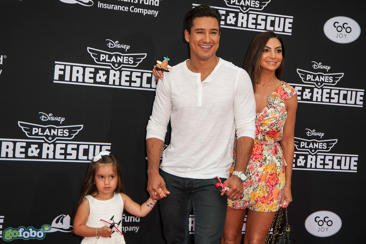 HOLLYWOOD, CA - JULY 15: TV Personality Mario Lopez (C), actress Courtney Mazza (R), and Gia Francesca Lopez attend the premiere of Disney's 'Planes: Fire & Rescue' at the El Capitan Theatre on Tuesday July 15, 2014 in Hollywood, California. (Photo by Tom Sorensen/Moovieboy Pictures)