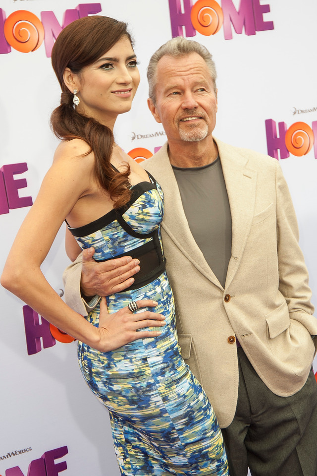 WESTWOOD, CA - MARCH 22: Actress Blanca Blanco and actor John Savage arrive for the Premiere Of Twentieth Century Fox And Dreamworks Animation's 'HOME' held at Regency Village Theatre on Sunday March 22, 2015 in Westwood, California. (Photo by Tom Sorensen/Moovieboy Pictures)