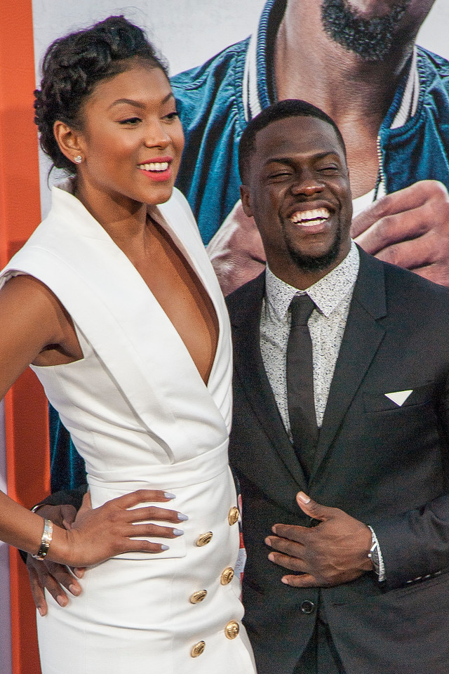 LOS ANGELES, CA - MARCH 25: Actor Kevin Hart (R) and Eniko Parrish arrive at the premiere of Warner Bros. Pictures' 'Get Hard' at the Chinese Theatre on March 25, 2015 in Los Angeles, California. (Photo by Tom Sorensen/Moovieboy Pictures)
