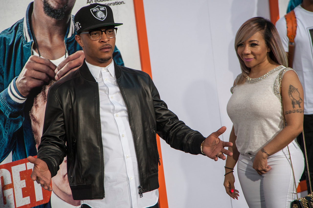 LOS ANGELES, CA - MARCH 25: Rapper T. I. (L) and Tameka Cottle arrive at the premiere of Warner Bros. Pictures' 'Get Hard' at the Chinese Theatre on March 25, 2015 in Los Angeles, California. (Photo by Tom Sorensen/Moovieboy Pictures)