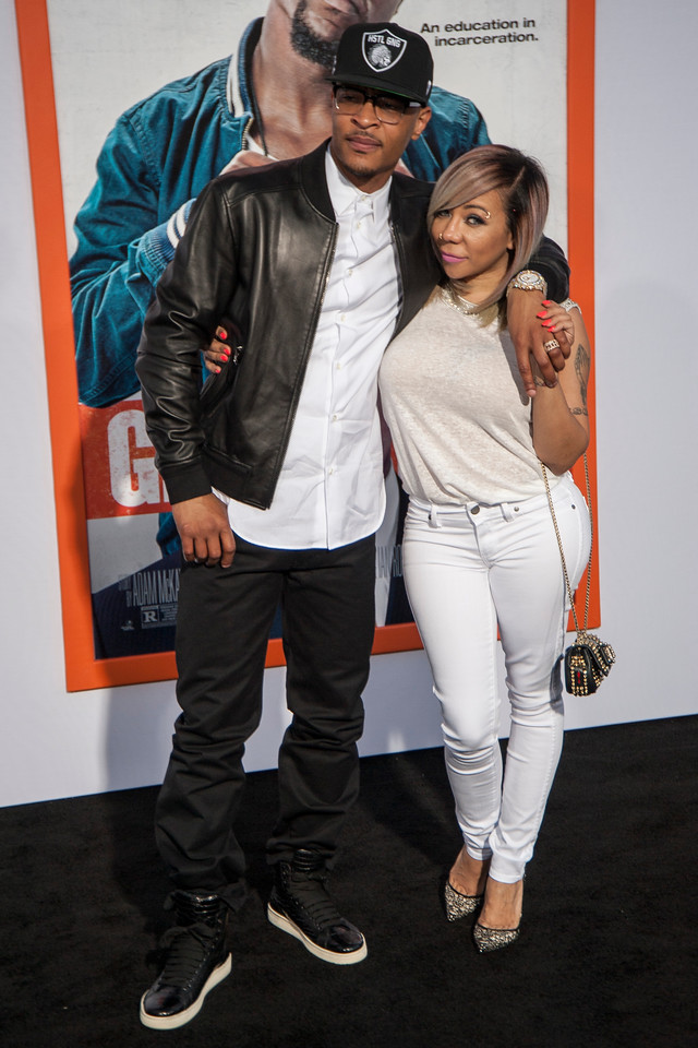 LOS ANGELES, CA - MARCH 25: Rapper T. I. (L) and Tameka 'Tiny' Cottle-Harris arrive at the premiere of Warner Bros. Pictures' 'Get Hard' at the Chinese Theatre on March 25, 2015 in Los Angeles, California. (Photo by Tom Sorensen/Moovieboy Pictures)