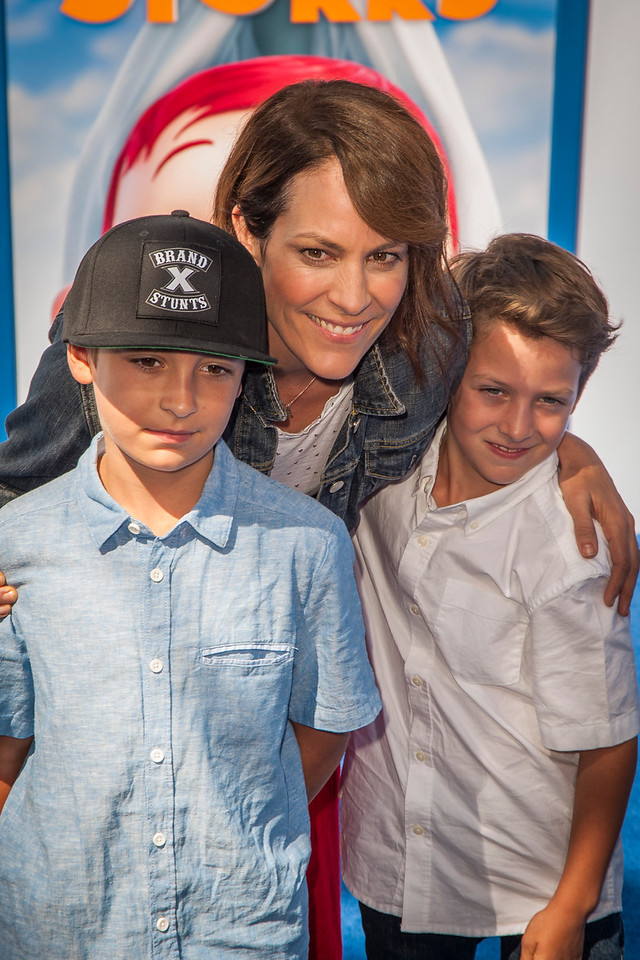 WESTWOOD, CA - SEPTEMBER 17: Actress Annabeth Gish with sons Cash Alexander Allen (L) and Enzo Edward Allen (R) attend the premiere of Warner Bros. Pictures' 'Storks' at Regency Village Theatre on Saturday September 17, 2016 in Westwood, California. (Photo by Tom Sorensen/Moovieboy Pictures)