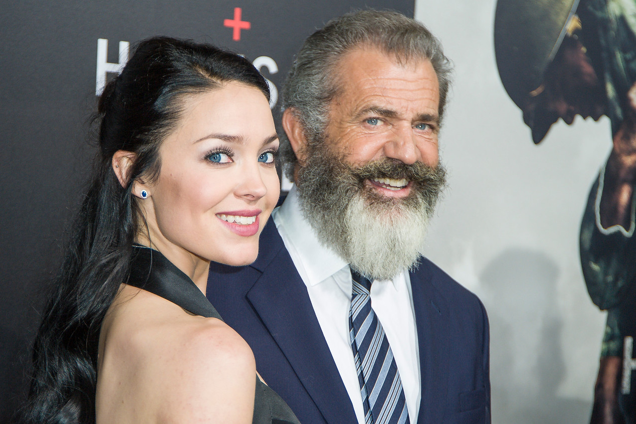 BEVERLY HILLS, CA - OCTOBER 24: Rosalind Ross (L) and director Mel Gibson attend the screening of Summit Entertainment's 'Hacksaw Ridge' at the Samuel Goldwyn Theater on Monday October 24, 2016 in Beverly Hills, California. (Photo by Tom Sorensen/Moovieboy Pictures)