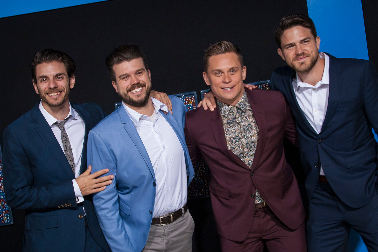 HOLLYWOOD, CA - FEBRUARY 21: Billy Magnussen (third from left) and friends attend the premiere of New Line Cinema and Warner Bros. Pictures' 'Game Night' at TCL Chinese Theatre on Wednesday, February 21, 2018 in Hollywood, California. (Photo by Tom Sorensen/Moovieboy Pictures)
