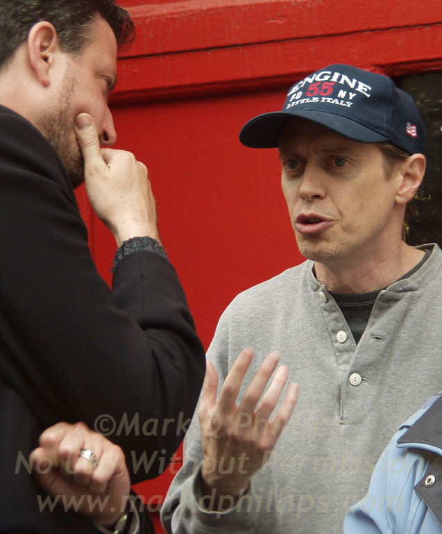 New York City Councilman Bill de Blasio talks with Steve Buscemi outside Engine 204 on Degraw Street closes.