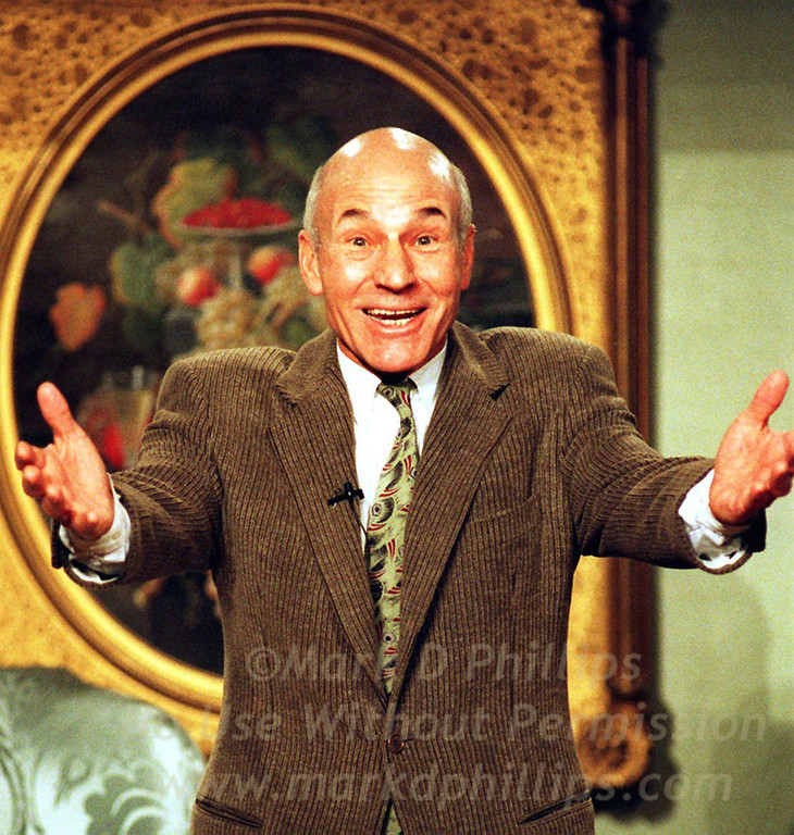 "Patrick Stewart performs from ""A Christmas Carol"" in his one man show during a reading from a first edition copy of the Dickens classic at Sothebys in New York City on December 18. 1997."