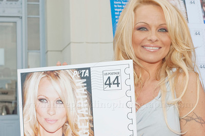 1036w Actress/Animal Rights Activist  Pamela Anderson and Game Show Host and Animal Rights Activist Bob Barker unveil PETA's new Vegetarian Icons Photo Stamp collectors' sheet at the Hollywood Post Office 11/29/2011. The USPS-approved postage stamps feature famous vegetarians dead and living incluidng Leonardo da Vinci, Ellen DeGeneres, Pamela Anderson, Bob Barker and Mohandes Gandhi.
